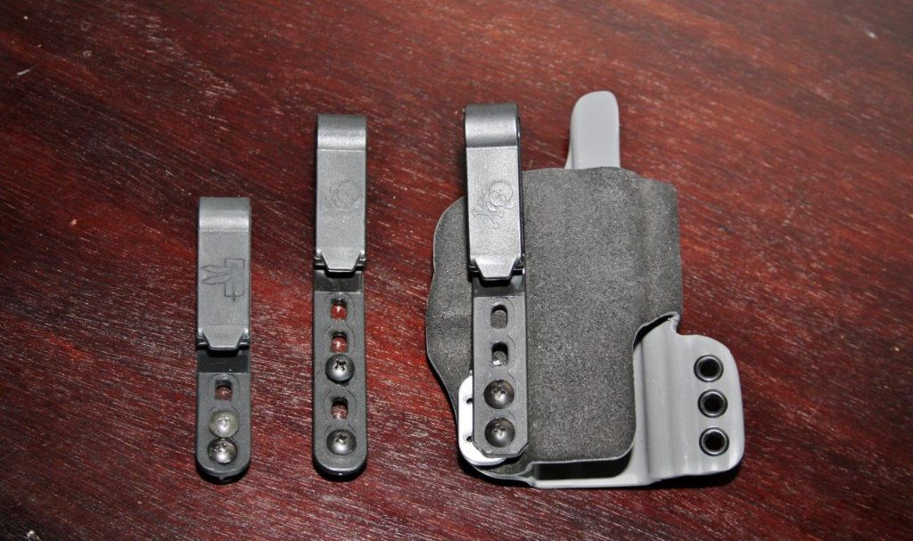 3 hole, 5 hole, and 4 holes clips. You don't get the HSP logo with the aftermarket clips
